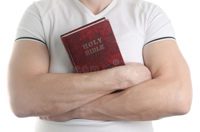 Man holding the Bible. Man holding the Holy Bible, isolated on white background royalty free stock photos