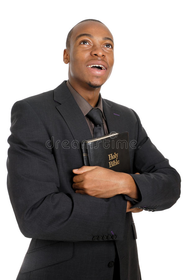 Man holding a bible showing commitment royalty free stock images