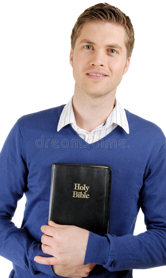 Man holding a bible showing commitment. This is an image of a man holding a bible showing commitment royalty free stock photos