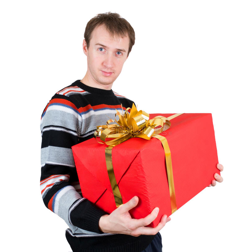 A man holding a big gift isolated royalty free stock images