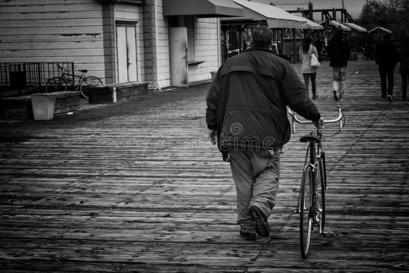 Man holding the bike stock photo