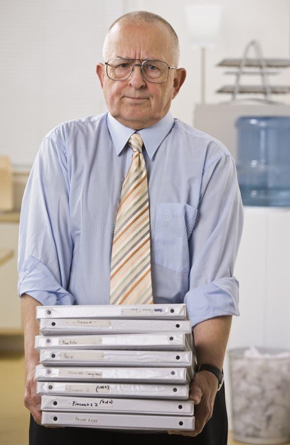 Man Holding Binders royalty free stock photos