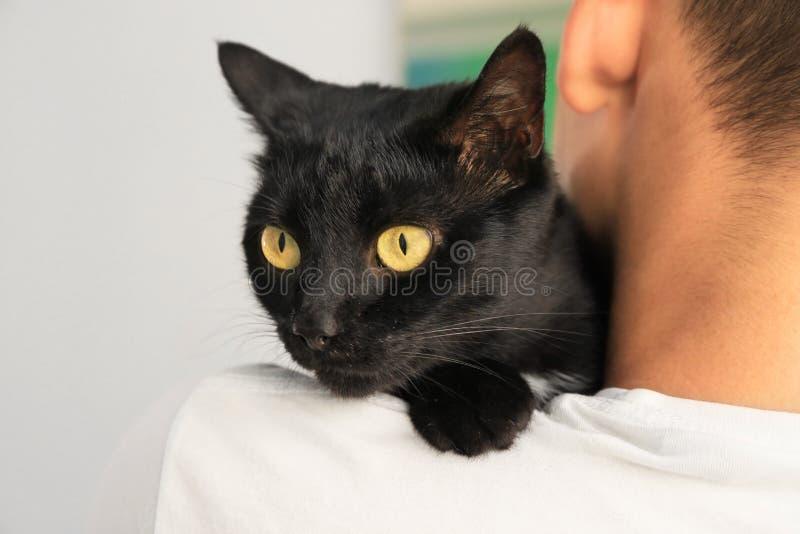 Man holding black cat. Adoption. Concept royalty free stock photos