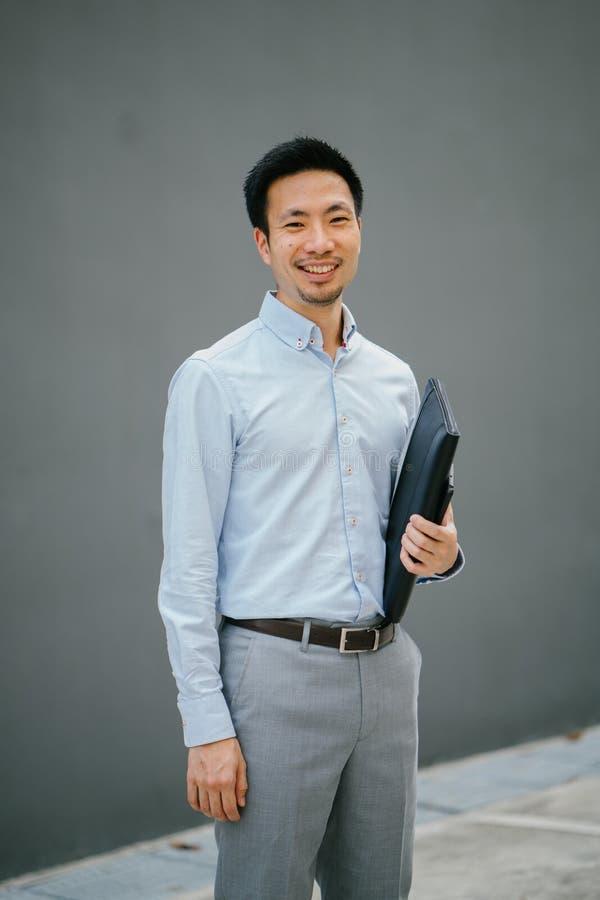 Man Holding Black Laptop Bag stock images