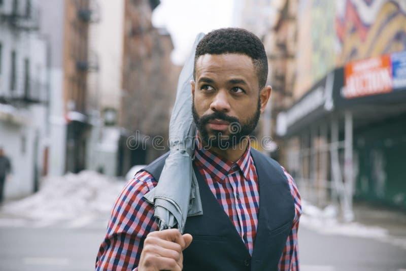 Man Holding Black Umbrella stock photos