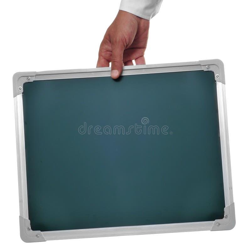 Man holding a blank chalkboard royalty free stock photos