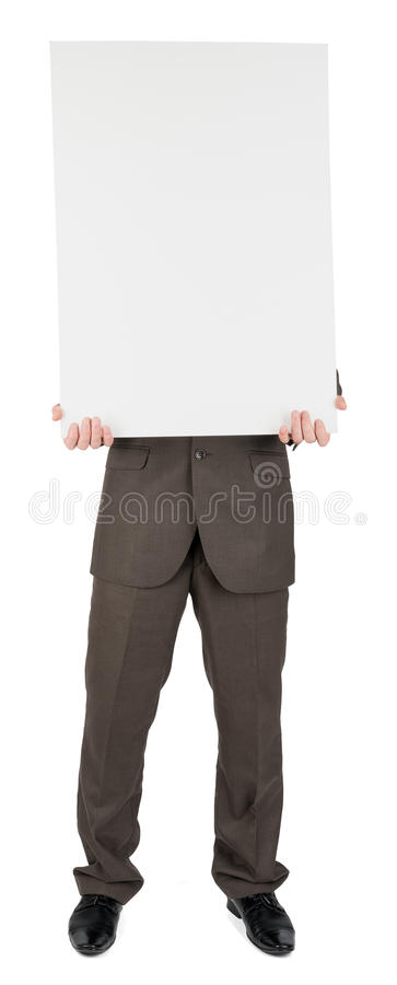 Man holding blank poster. Isolated on white background royalty free stock photo