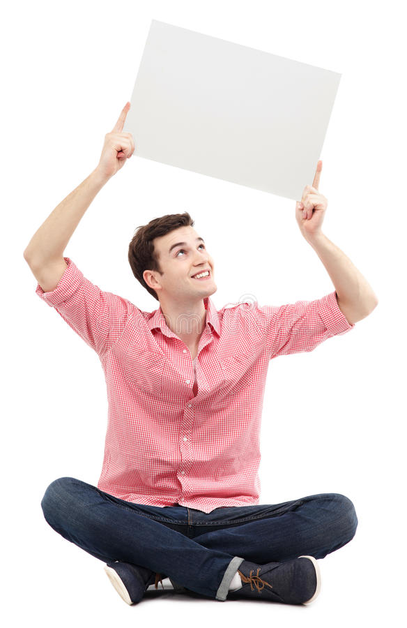 Man holding blank poster. Young man holding blank poster stock photography