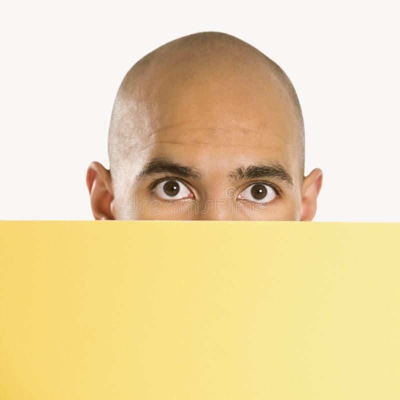 Man holding blank sign. stock photo