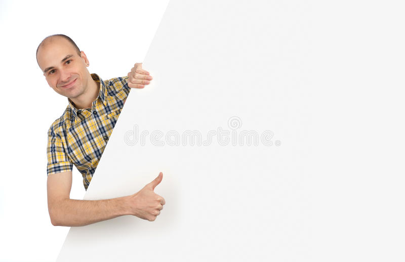 Man Holding A Blank Sign In Front Of Him Stock Photography