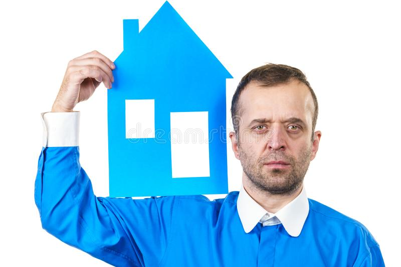 Man holding blue house model. Man holding blue conceptual house model. Real estate agent, home ownership concept. Studio shot on white isolated background stock photo