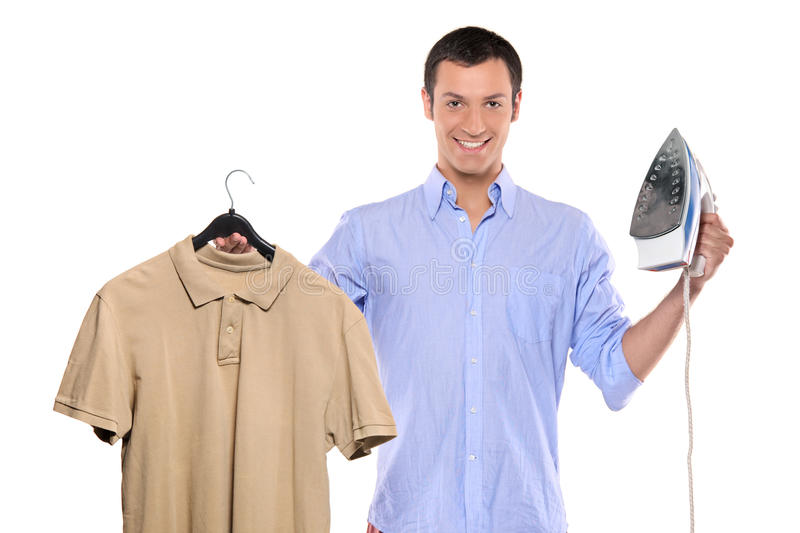 Man holding a blue and white clothing iron. And his T-shirt isolated on white background stock photography