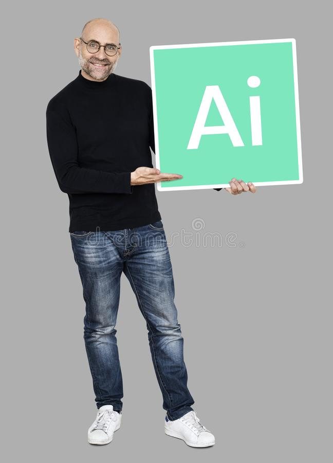 Man holding a board with Artificial Intelligence stock images