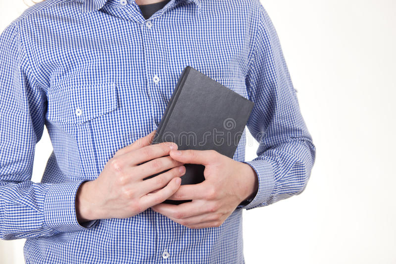 Man holding book. Isolated on white background stock photography