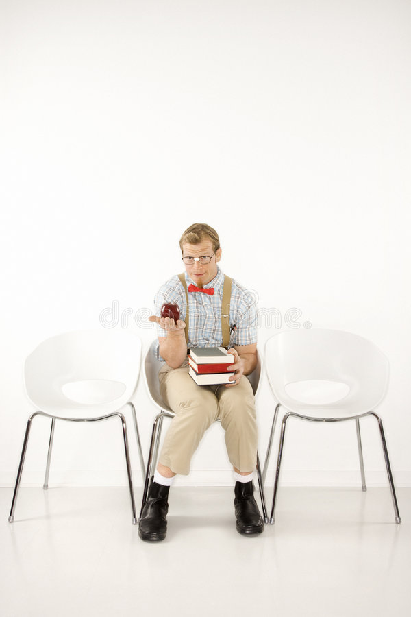 Man holding books and apple. royalty free stock image