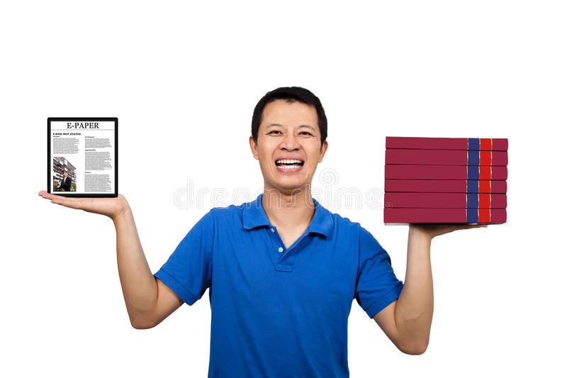 Man holding books and E-books royalty free stock photo