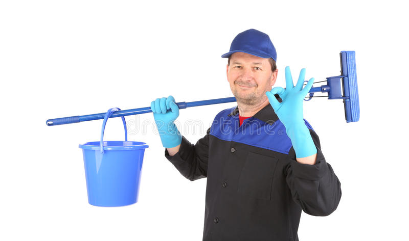 Man holding broom and bucket. stock photography