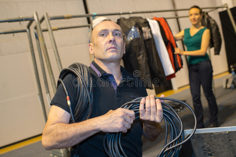 Man holding bunch cables royalty free stock image