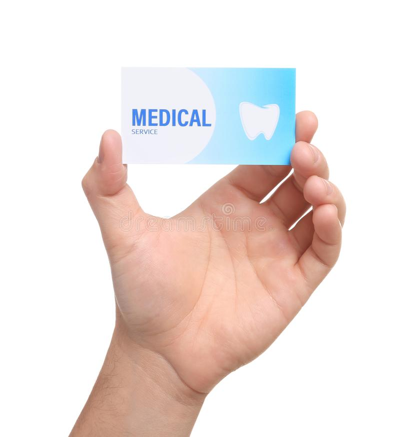Man holding business card isolated on white, closep. Dental medical service stock images