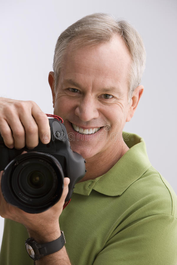 Man Holding Camera Stock Photography