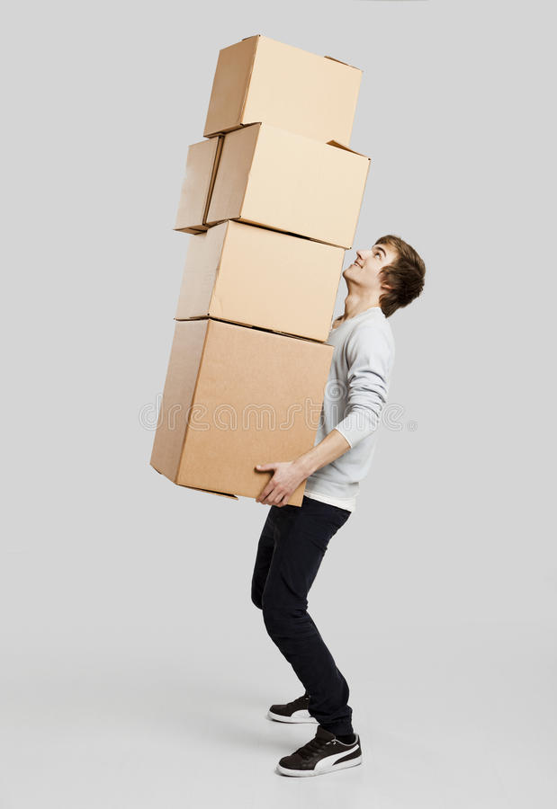 Download Man holding card boxes stock photo. Image of carton, friendly - 36228140