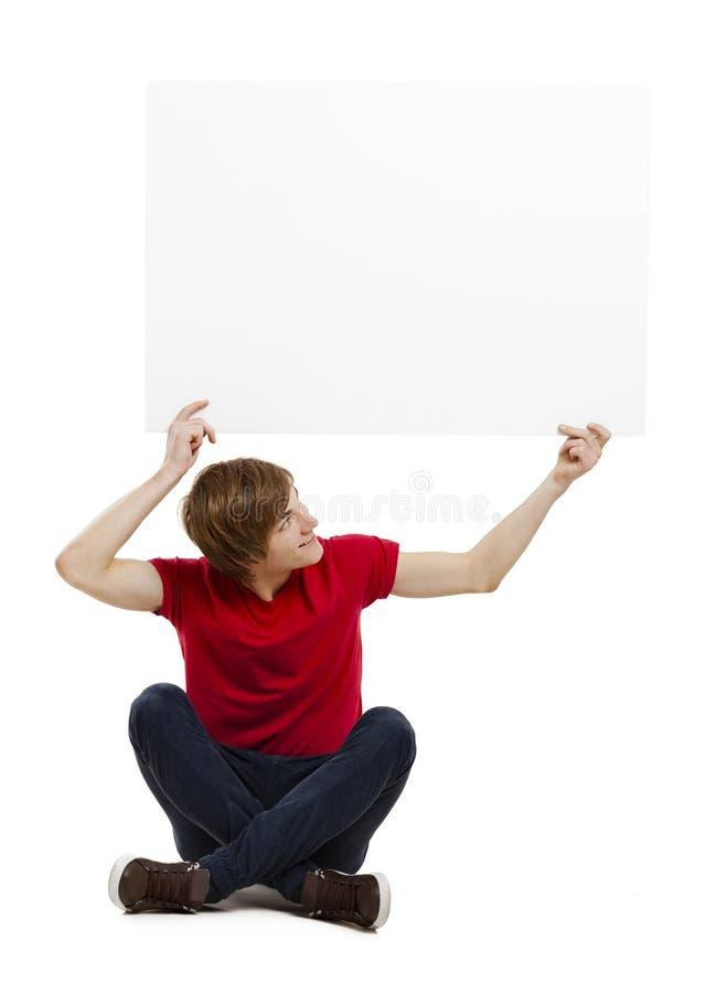 Download Man holding a cardboard stock photo. Image of peek, billboard - 24043050