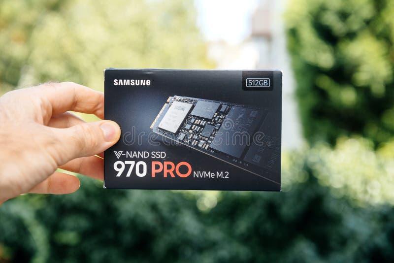 Man holding cardboard box of SSD NVME Samsung Drive royalty free stock photos