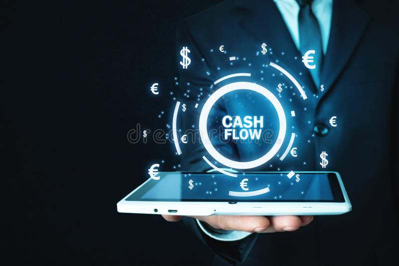 Man holding Cash Flow words with currency symbols. Finance concept stock images