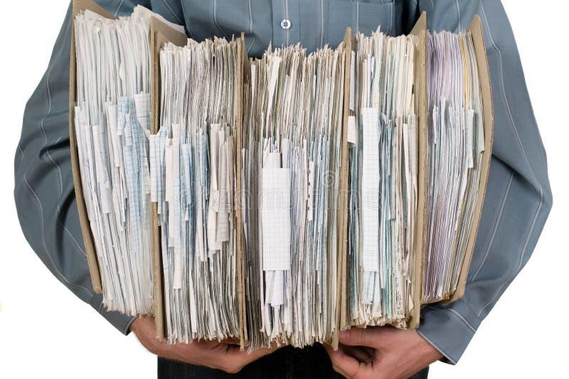 Man holding catalog of documents stock photo