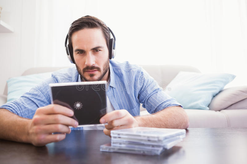 Man holding cd while listening to music stock images
