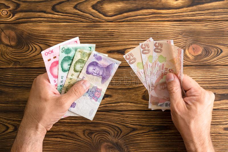 Man holding Chinese Yuan and Turkish Lira royalty free stock images