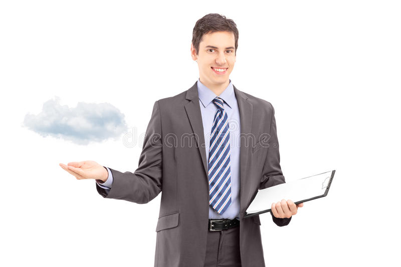 Man holding a clipboard and gesturing with hand, symbolizing cloud computing. Young professional man holding a clipboard and gesturing with hand, symbolizing royalty free stock photo