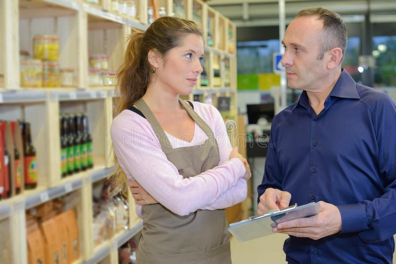 Man holding clipboard sales assistant looking reproachful stock images