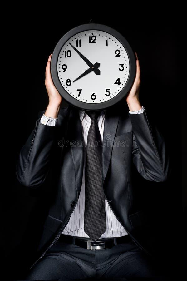 Man Holding Clock Royalty Free Stock Image