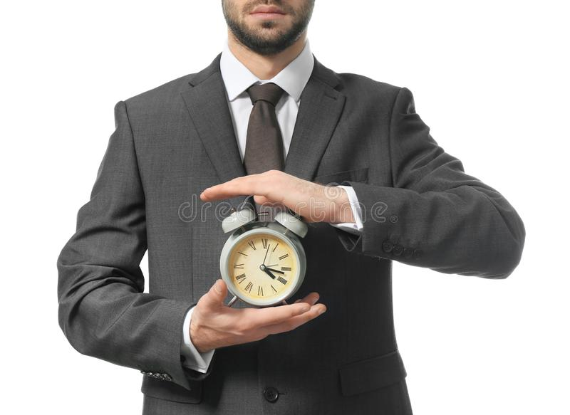 Man holding clock on white background. Time management concept royalty free stock photography