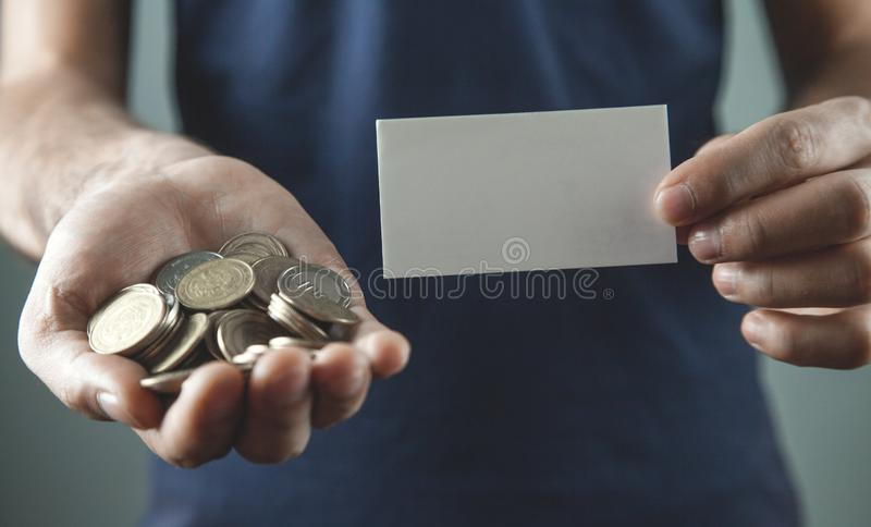 Man holding coins with blank business card royalty free stock image
