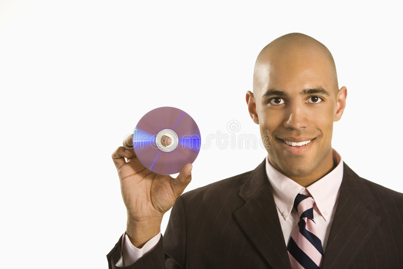 Man holding compact disc. African American man smiling holding out compact disc royalty free stock photos