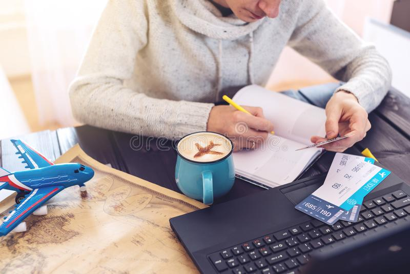 Man holding credit card and buys plane tickets on Internet. Man holding a credit card and buys plane tickets on the Internet working on the laptop. The concept stock images