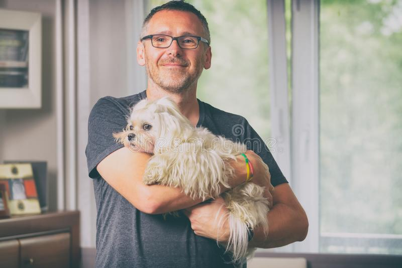 Man holding a dog stock images