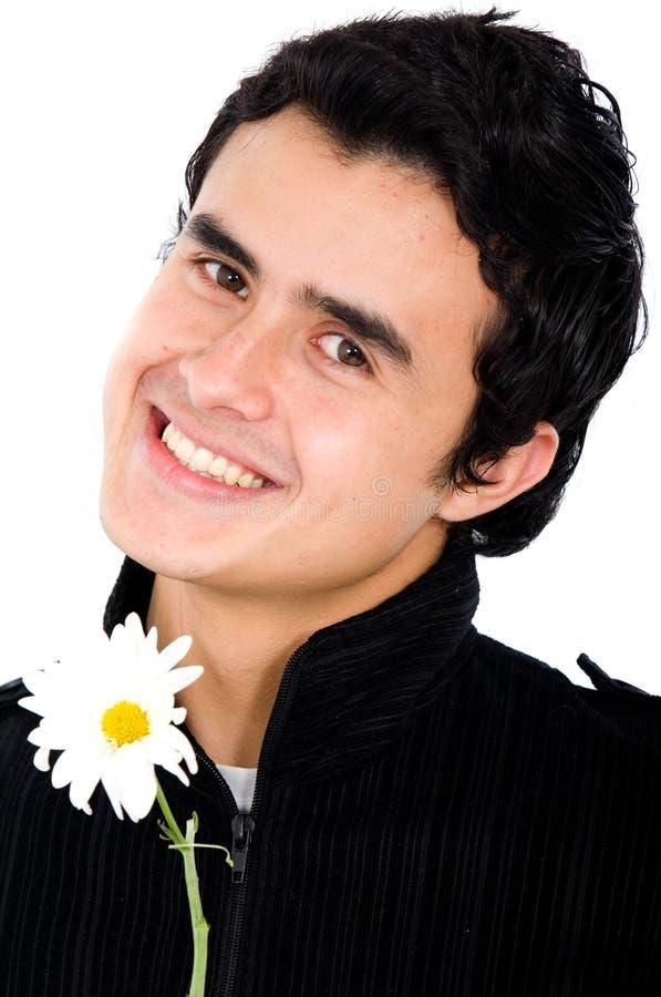 Man holding a daisy flower