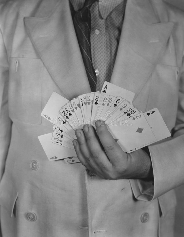 Man holding deck of cards royalty free stock photos