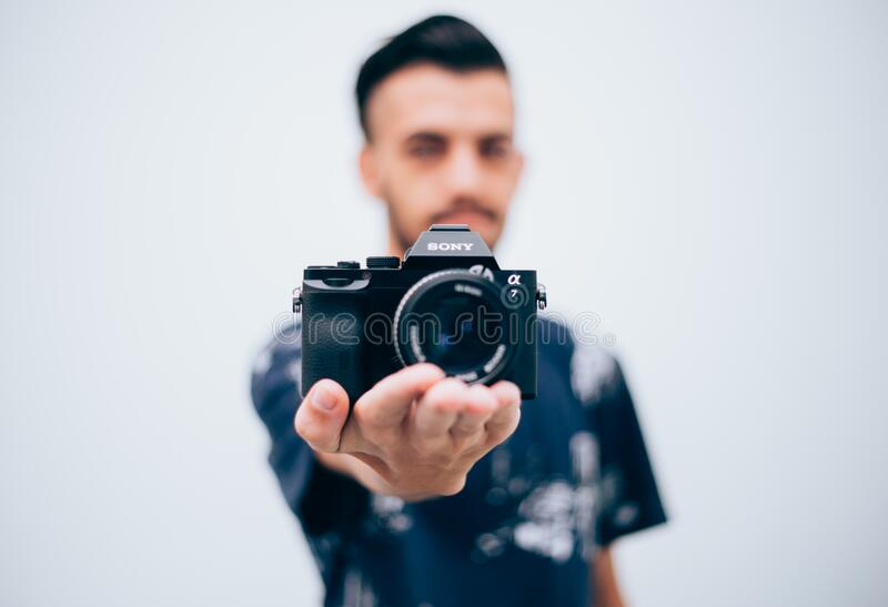 Man holding a digital camera royalty free stock images