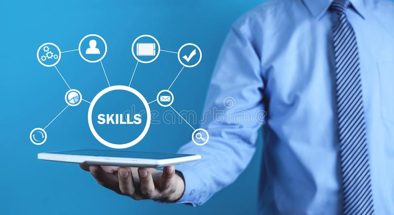 Man holding digital tablet. Business Skills Concept royalty free stock image
