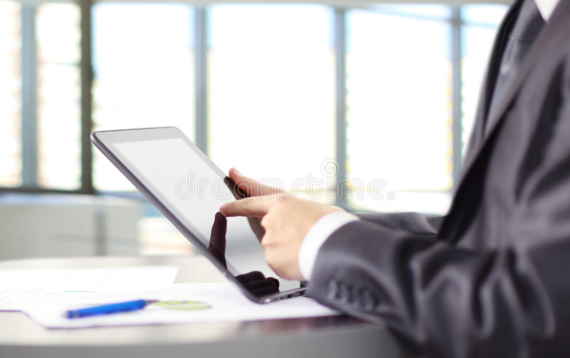 Man holding digital tablet stock photo