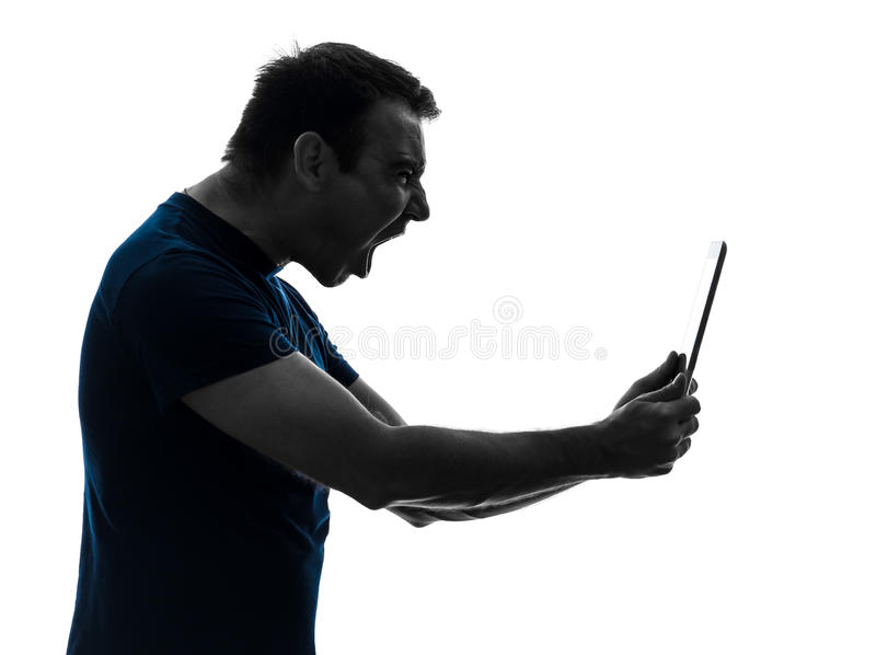 Man holding digital tablet screaming angry furious. One caucasian man holding digital tablet screaming angry furious on white background royalty free stock photography