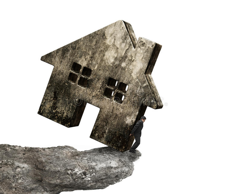 Man holding dirty concrete house on cliff edge royalty free stock image