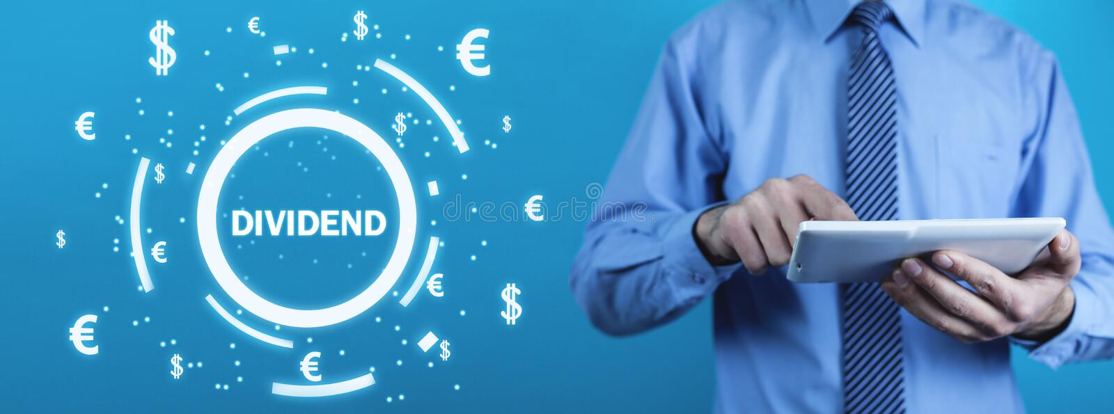 Man holding Dividend text with currency symbols. Business stock image