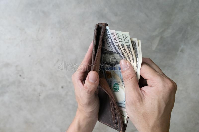 Man holding dollar banknote.young businessman holding money.Business and finances making and saving money concept royalty free stock photos