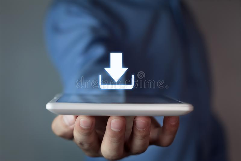 Man holding download icon. stock image