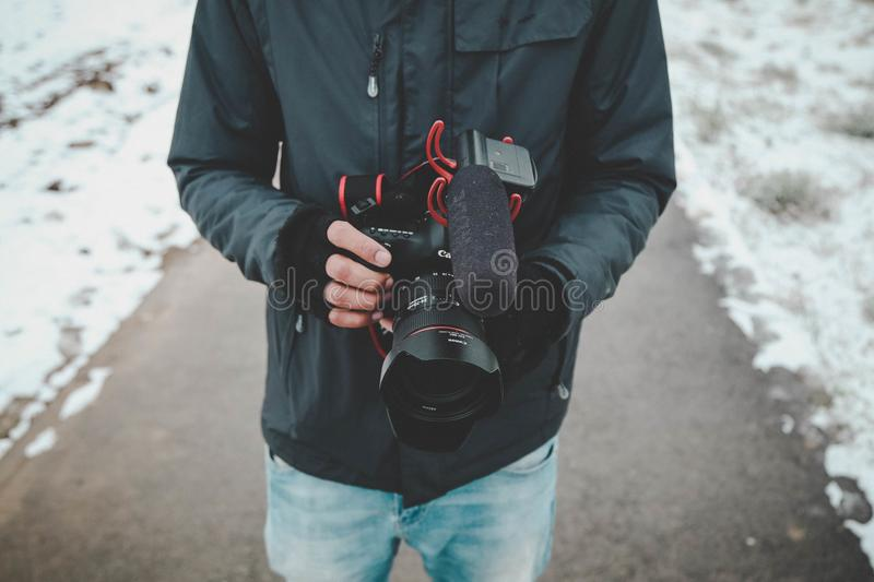 Man Holding Dslr Camera stock image